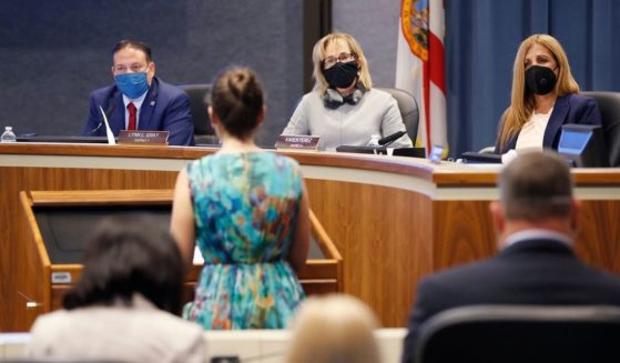 Schools board members looks on while members of the public speak during the special board meeting at the Hillsborough County Public Schools district office on Aug. 6, 2020, in Tampa, Florida.