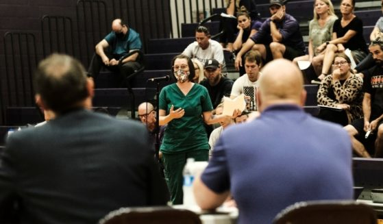 People speak during a local board of education meeting at Schoolcraft High School on Aug. 23 in Schoolcraft, Michigan.