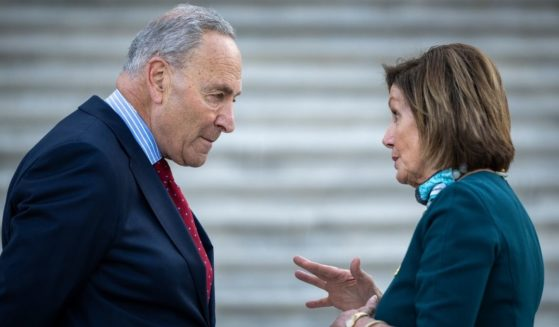 Democratic Senate Majority Leader Chuck Schumer, left, talks with Speaker of the House Nancy Pelosi on the steps of the U.S. Capitol on June 14, 2021.