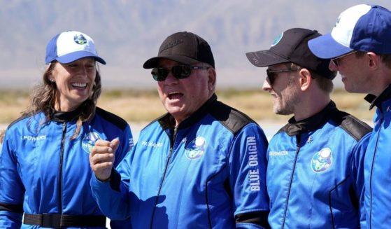 William Shatner speaks as his fellow passengers -- from left, Audrey Powers, Chris Boshuizen and Glen de Vries -- look on at the Blue Origin spaceport near Van Horn, Texas, on Oct. 13.