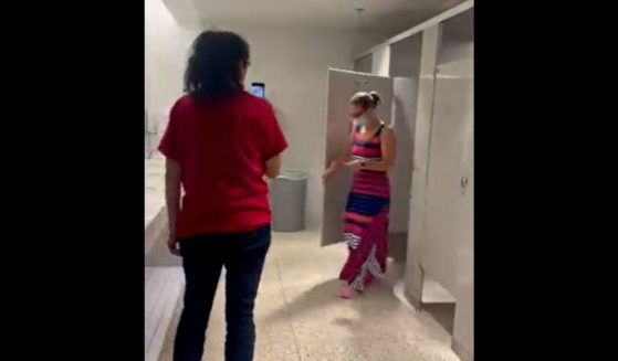 Immigration activists record themselves harassing Democratic Sen. Kyrsten Sinema in a bathroom at Arizona State University's downtown Phoenix campus.