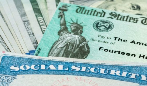 A Social Security card, a Treasury check and a stack of $100 bills are pictured in the stock image above.