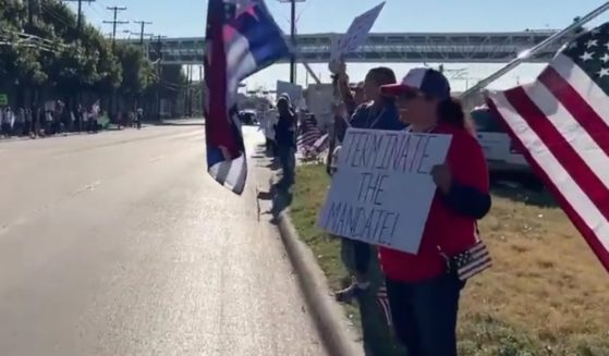 Current and former Southwest Airlines employees gather outside the company's Dallas headquarters on Monday to protest the company's vaccine mandate.