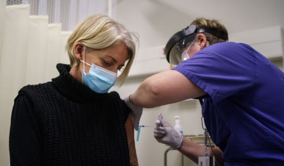 A woman receives the first of two doses of the Pfizer-BioNtech COVID-19 vaccine at Östra Hospital in Gothenburg, Sweden, on Jan. 14.