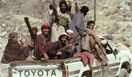Taliban soldiers drive in a pickup truck to Surobi, Afghanistan on Oct. 16, 1996.