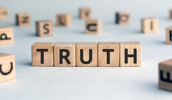"""Wooden blocks with letters spelling the word """"truth"""" are seen in the stock image above."""