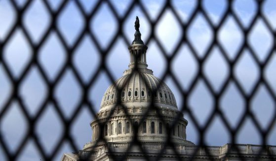 The U.S. Capitol Dome is seen through security fencing on May 12, 2021, in Washington, D.C.