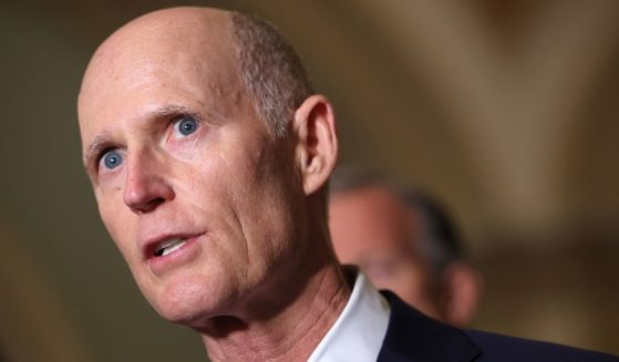 Florida Republican Sen. Rick Scott speaks to reporters after a Republican Senate luncheon at the U.S. Capitol in Washington on June 15.