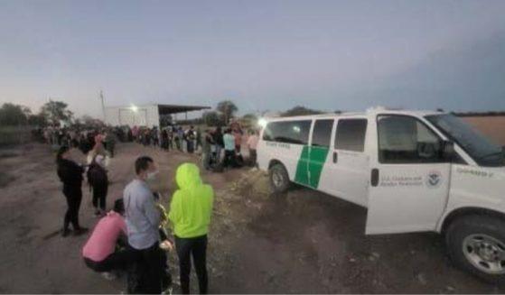 U.S. Border Patrol agents arrest illegal immigrants near Normandy, Texas, on Monday.