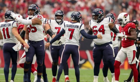 Ka'imi Fairbairn, #7 of the Houston Texans, celebrates with teammates after kicking a field goal in the second quarter against the Arizona Cardinals in the game at State Farm Stadium on Sunday in Glendale, Arizona.