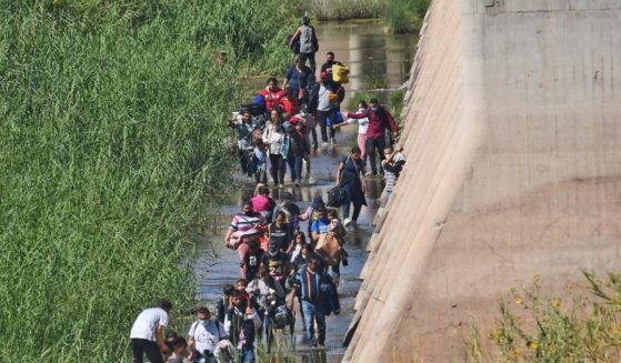 Migrants attempt to cross the border from Mexico into San Luis, Arizona, on Oct. 10.