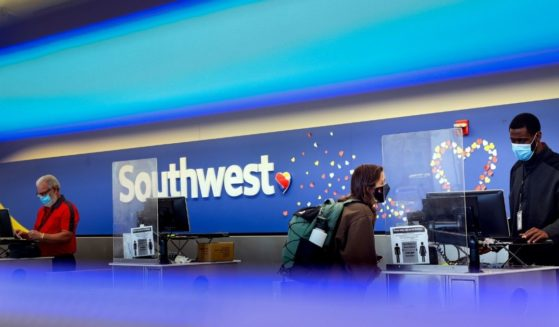 A traveler checks in at the Southwest Airlines ticketing counter at Baltimore Washington International Thurgood Marshall Airport on Oct. 11, in Baltimore, Maryland.