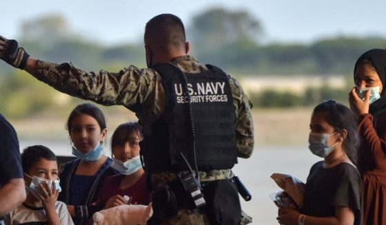 Refugees receive instructions from a U.S. navy soldier as they disembark from a US air force aircraft after an evacuation flight from Kabul at the Rota naval base in Rota, southern Spain, on Aug. 31.
