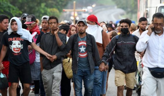 Migrants heading to Mexico City to request asylum and refugee status walk in caravan in Huehuetan, Chiapas State, Mexico, on Oct, 25.