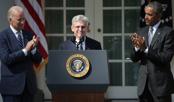 Then-President Barack Obama and then-Vice President Joe Biden stands with then-Judge Merrick B. Garland while nominating him to the U.S. Supreme Court, in the Rose Garden at the White House, March 16, 2016, in Washington, D.C.