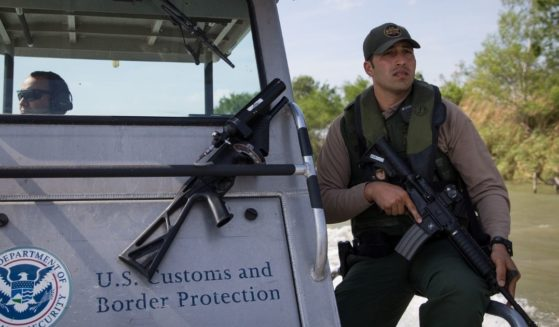 A Border Patrol Riverine Unit patrols the Rio Grande River on the border between Mexico and the United States on Monday, March 26, 2018, near McAllen, Texas.