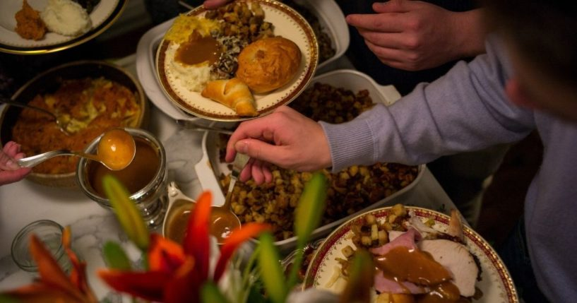 Unidentified diners serve themselves food at a traditional Thanksgiving Day family gathering in Bloomfield Hills, Michigan on Nov. 26, 2015.