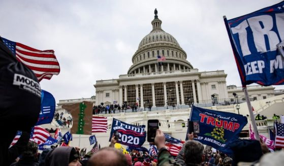 Trump supporters stand outside the U.S. Capitol following a rally with then-President Donald Trump on Jan. 6, in Washington, D.C.