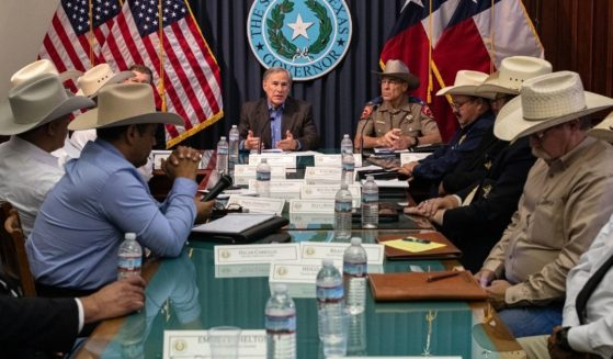 Texas Gov. Greg Abbott meets with sheriffs from border counties in July in Austin.
