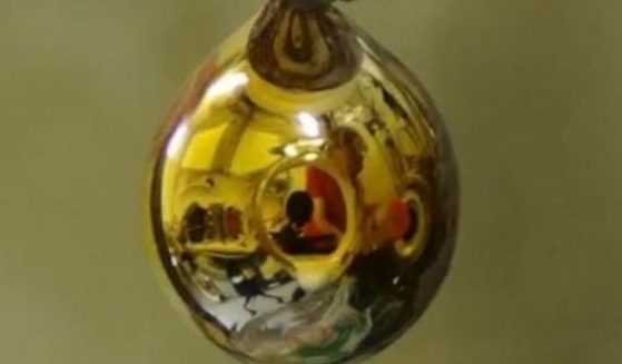 In an experiment by a group of scientists, a golden shine appears on purified water.