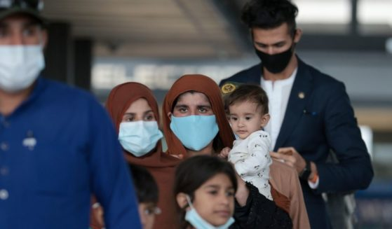 Afghan refugees walk through a departure terminal at Dulles International Airport in Dulles, Virginia, on Aug. 31.
