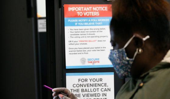 A voter casts a ballot at the Metropolitan Library in Atlanta, Georgia, on Nov. 3, 2020.