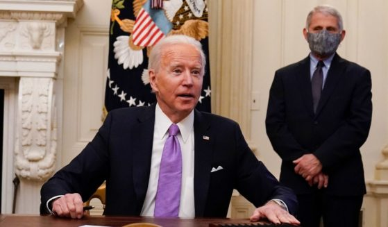 President Joe Biden is pictured in a Jan. 21 file photo in the Oval Office with Dr. Anthony Fauci, director of the National Institute of Allergy and Infectious Diseases.
