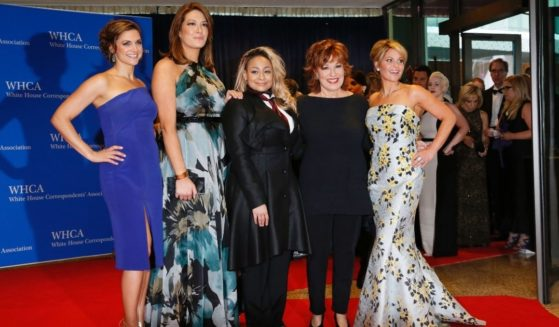 From left, the cast of 'The View' -- Paula Faris, Michelle Collins, Raven-Symone, Joy Behar and Candace Cameron Bure -- arrives for the White House Correspondents' Association annual dinner in Washington, D.C., on April 30, 2016, Bure's last year on the TV show.