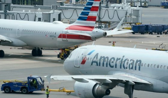 American Airlines passenger jets prepare for departure near a terminal at Boston Logan International Airport in Boston on July 21.