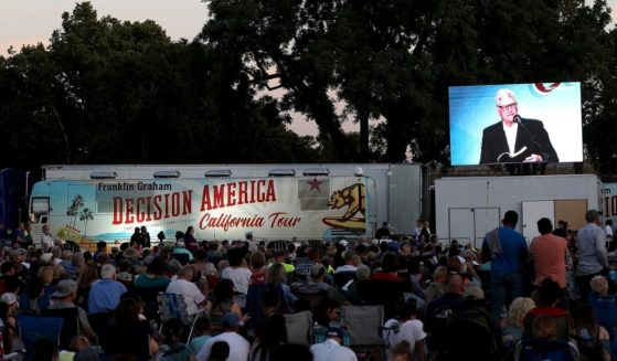 Attendees look on as the Rev. Franklin Graham speaks during his 'Decision America' California tour at the Stanislaus County Fairgrounds in Turlock, California, on May 29, 2018. Graham was touring leading up to the California primary election on June 5. Now, Graham is pointing out America's declining work ethic.