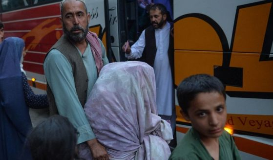 Refugees wait to board a bus in Kabul, Afghanistan, on Sept. 29.