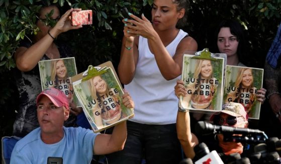 Gabby Petito supporters hold signs during a news conference in North Port, Florida, on Wednesday.