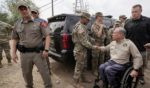 Texas Gov. Greg Abbott shakes a National Guard member's hand after a Sept. 21 news conference in in Del Rio, Texas.