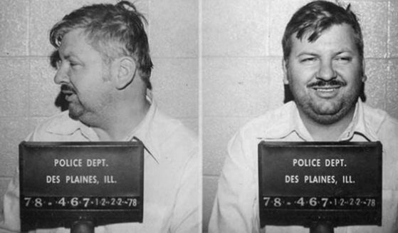 Serial killer John Wayne Gacy poses for his mug shot in December 1978 at the Des Plaines Police Department.