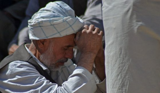 A man mourns at a graveyard in Kandahar, Afghanistan, on Oct. 16.
