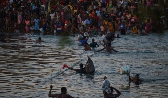 Haitian migrants cross the US-Mexico border on the Rio Grande on Sept. 19.