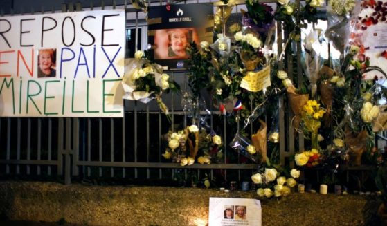 A March 28, 2018 photo shows flowers and placards adorn the outside of Mireille Knoll's apartment in Paris, France.