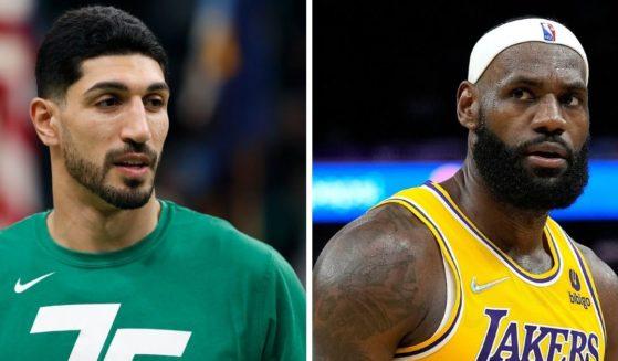Boston Celtic Enes Kanert, left, Los Angeles Laker LeBron James, right.