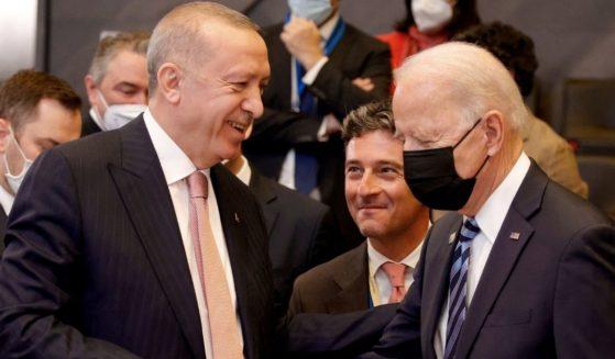 President Joe Biden speaks with Turkish President Recep Tayyip Erdogan at the North Atlantic Treaty Organization headquarters in Brussels on June 14.