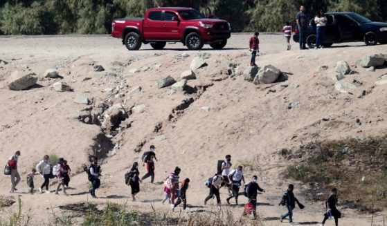 Migrants try to enter the U.S. from Mexico at the border in San Luis, Arizona, on Oct. 10.