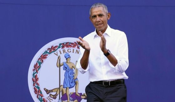 Former President Barack Obama arrives for a rally in Richmond with Virginia Democratic gubernatorial candidate Terry McAuliffe on Oct. 23, 2021.