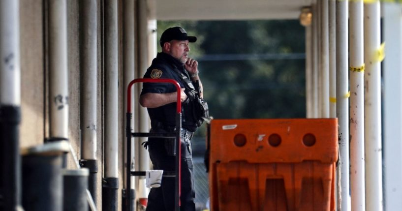 Memphis Police Department officers examine the scene outside the post office in Memphis, Tennessee, on Tuesday.