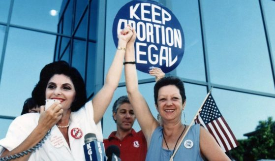 """Attorney Gloria Allred, left, stands with """"Jane Roe"""" plaintiff Norma McCorvey in Burbank, California, on July 4, 1989."""