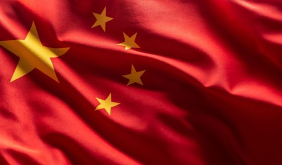A stock photo shows the Chinese flag blowing in the wind.