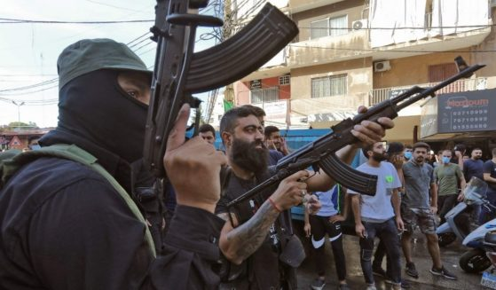 Members of the Hezbollah movement in Lebanon fire a gun during a funeral on Friday.