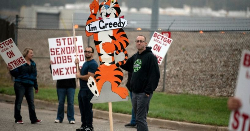 First shift worker Travis Huffman and other BCTGM Local 3G union members are seen striking outside the Kellogg plant in Battle Creek, Michigan, on Tuesday.