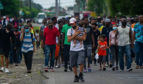 Haitian and Central American migrants march to the Siglo XXI Migratory Station in Tapachula, Chiapas, Mexico, on Sept. 15.
