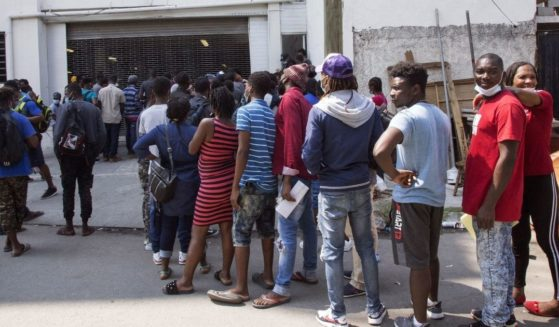 Haitian migrants wait to enter the National Commission for Refugees offices to ask for asylum in Monterrey, Mexico, on Sept. 27.