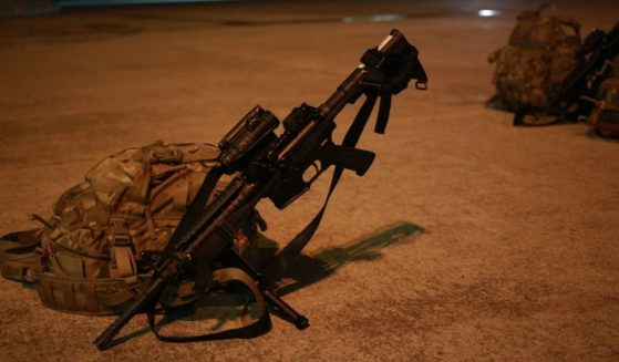 An M4 carbine lies on the tarmac in Fort Campbell, Kentucky, on Sept. 1, 2014.