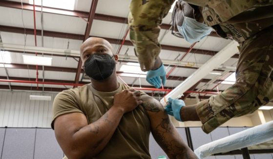 Preventative Medicine Services NCOIC Sergeant First Class Demetrius Roberson administers a COVID-19 vaccine to a soldier on Sept. 9, 2021 in Fort Knox, Kentucky.